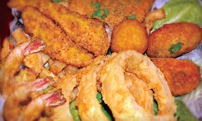 Fish Place TX5 - Multiple Locations: Cajun-Style Seafood at Fish Place TX5 (Half Off). Three Options Available.