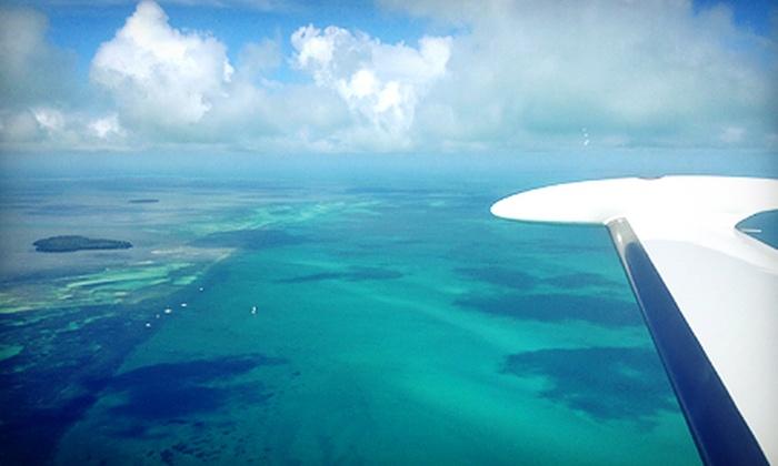 Beach Aviation - Boca Raton: $199 for a Round-Trip Flight for One to Grand Bahama, Orlando, or the Florida Keys from Beach Aviation ($450 Value)