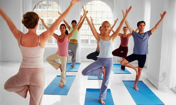 East Meets West Yoga Center - Old Courthouse: 5, 10, or 20 Yoga Classes at East Meets West Yoga Center (Up to 71% Off)