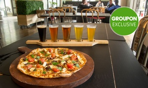 Uptown Freehouse: Pizza to Share and Beer Paddle Each for 2 ($39), 4 ($78) or 6 People ($117) at Uptown Freehouse (Up to $234 Value)