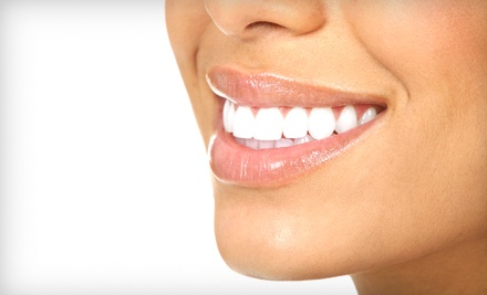 Dental Exam, Cleaning, and X-rays with Take-Home or Custom Whitening Trays at A Beautiful Smile (83% Off)