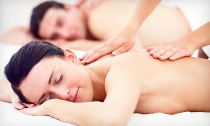 The Oasis Salon & Spa - Springfield: Hot-Stone or Aromatherapy Massage or Candlelit Couples Massage with Chocolates at The Oasis Salon & Spa (Half Off)