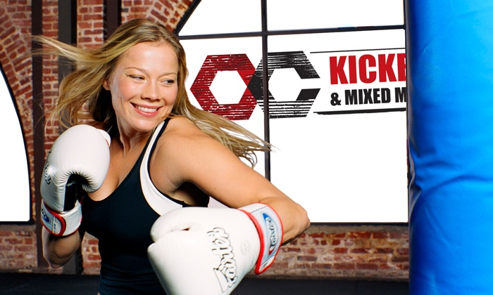 OC Kickboxing & Mixed Martial Arts - Irvine Business Complex: One Month of Classes for Kids or Adults at OC Kickboxing & Mixed Martial Arts (Up to 91% Off). Five Options.