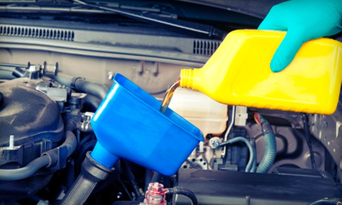 Meineke Car Care Center - Fresno: Basic or Preferred Oil-Change Package with Tire Rotation and Fluid Top-Off at Meineke Car Care Center (Half Off)