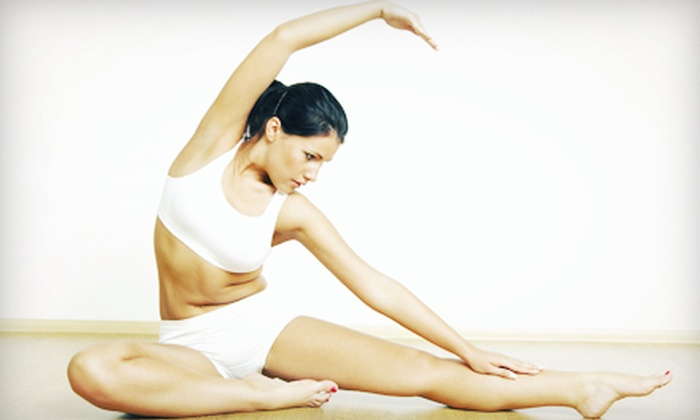 Yoga Planet Studio - Rochester: 5 or 10 Drop-In Yoga Classes at Yoga Planet Studio (Up to 70% Off)