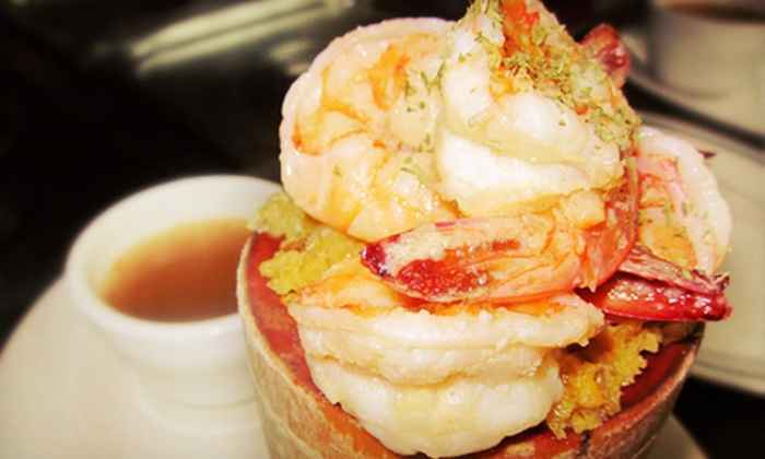 Benny's Seafood Restaurant - Multiple Locations: Puerto Rican Cuisine and Drinks at Benny's Seafood Restaurant (Half Off). Two Options Available.