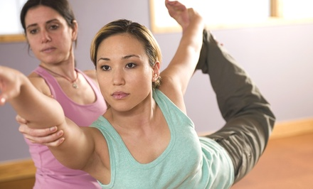 Five Yoga Classes or One Month of Unlimited Yoga at Hot Yoga Wellness (Up to 76% Off)