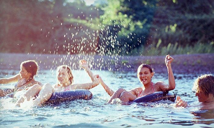 Chuck's Tubes - Downtown New Braunfels: River Tubing with Tubes, Cooler Tube, and Shuttle Pass for Two or Four at Chuck's Tubes (Up to 53% Off)