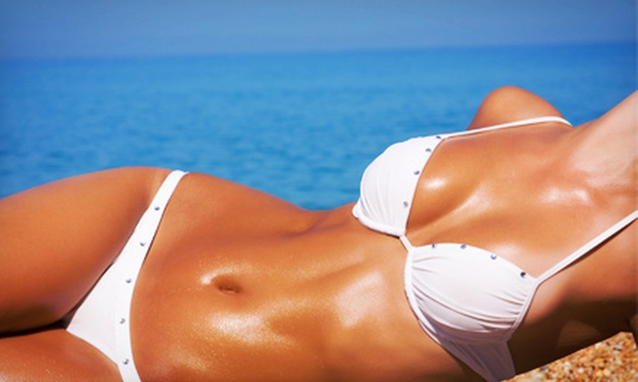 SunLounge Tanning Studios - West Central Valley: Spray Tans or UV Tanning at SunLounge Tanning Studios (Up to 64% Off). Three Options Available.