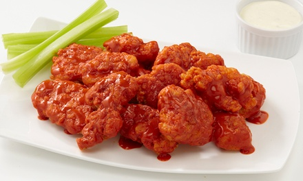 Two or Four Groupons for Wings or Family-Style Meal with 100 Wings and Four Sides at Planet Wings (Up to 50% Off)