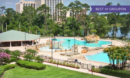 groupon daily deal - Stay at Wyndham Lake Buena Vista Resort in Orlando, with Dates into May