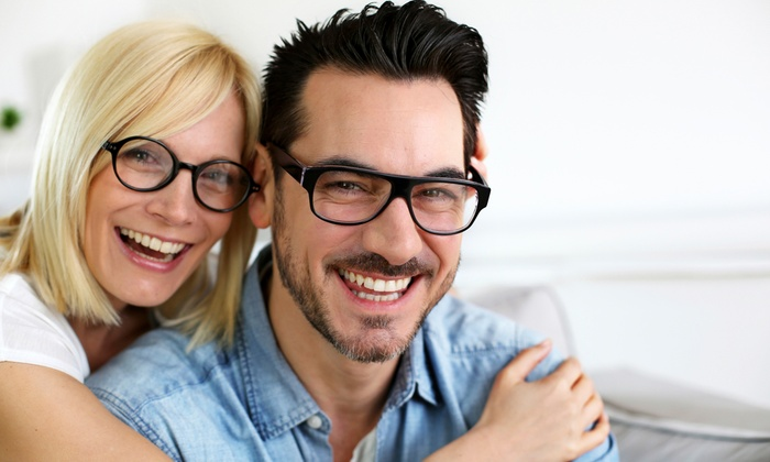 Precise Optique - North Corona: $29 for Eye Exam and $225 Toward Complete Pair of Glasses or Prescription Sunglasses at Precise Optique ($310 Value)