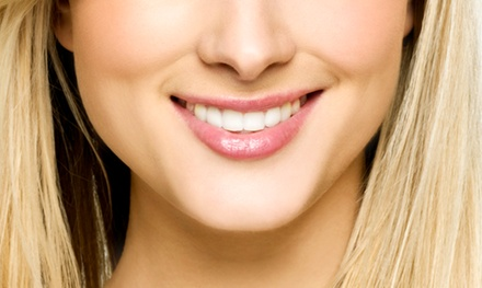 $2,799 for a Complete Invisalign Treatment with Ginger Price, DDS ($5,435 Value)