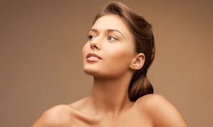 A Total Tan Spa: 5 Tanning-Bed Sessions or 2 Airbrush Tans at A Total Tan Spa (Up to 81% Off)