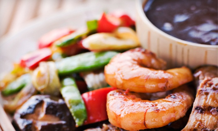 Happy Banzai - Millcreek Center: Japanese Steakhouse Dinner or Lunch for Two or Four at Happy Banzai (Up to 52% Off)
