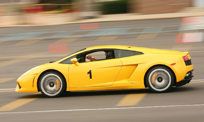 Imagine Lifestyles - Sears Centre Arena: Three-Lap High-Speed Driving or Ride-Along Experience in Ferrari or Lamborghini from Imagine Lifestyles (Up to 60% Off)
