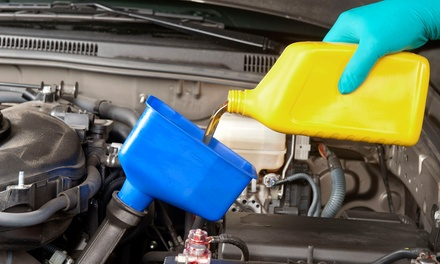 Oil-Change Packages at Carney Tire and Car Care Center (Up to 73% Off). Three Options Available.