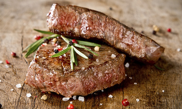 McBride's Steakhouse - McBride's Steakhouse: $29 for $50 Towards Lunch for Two or $36 for $60 Towards Dinner for Two at McBride's Steakhouse (Up to 42% Off)