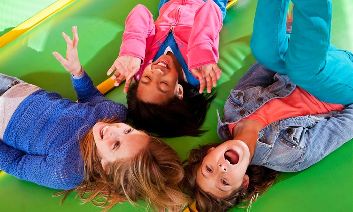 Lazer Kraze - Orange: Inflatables and Drinks for Two, or Inflatables, Drinks, and Pizza for Four at Lazer Kraze (Up to 51% Off)