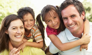 Uintah Smiles: Dental Exam with Cleaning and X-rays for a Child or Adult at Uintah Smiles (Up to 78% Off)