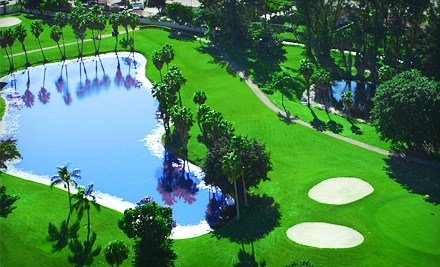 18-Hole Round of Golf for One, Two, or Four with Cart, Range Balls, and Drinks at Poinciana Golf Club (Up to 64% Off)