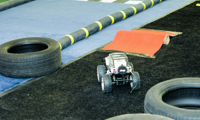 Spoiled Rotten Raceways for Boys - Baltimore: Game Lounge with Drinks and Snacks or NASCAR Package at Spoiled Rotten Raceway for Boys (Up to 52% Off)
