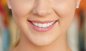Dr. Massimo Baroni: Visita, igiene dentale e smacchiamento con air flow o sbiancamento al laser (sconto fino a 83%)