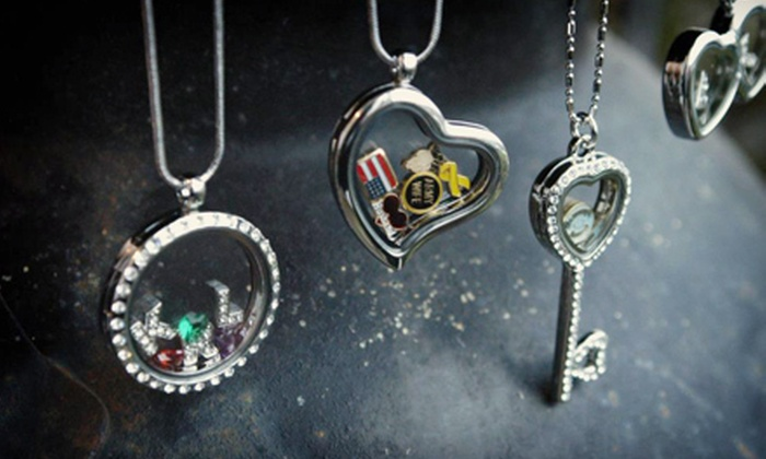 Stamp the Moment: Personalized Lockets, Charms and Rings from Stamp the Moment (Up to 61% Off). Two Options Available.