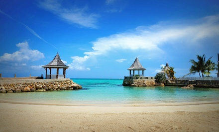 groupon daily deal - ✈ 4- or 6-Night All-Inclusive Stay with Airfare. Includes Taxes and Fees. Price per Person Based on Double Occupancy.