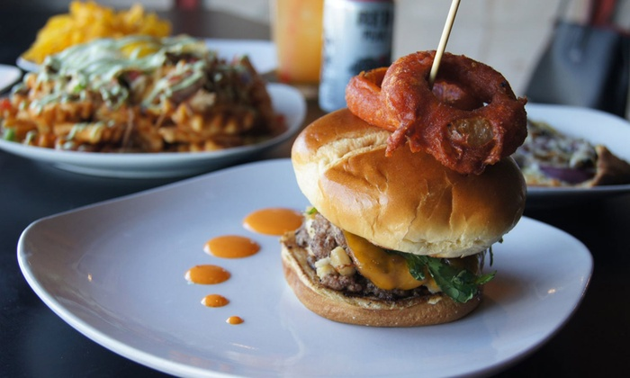 Guyutes - Uptown 23rd District: Burgers, Gourmet Pizza, and Wraps at Guyutes (40% Off). Two Options Available.