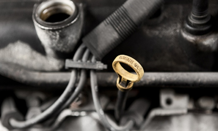 Carolina Muffler and Brakes - North Charleston: One or Two Oil Changes with Tire Rotations and Safety Inspections at Carolina Muffler and Brakes (Up to 60% Off)