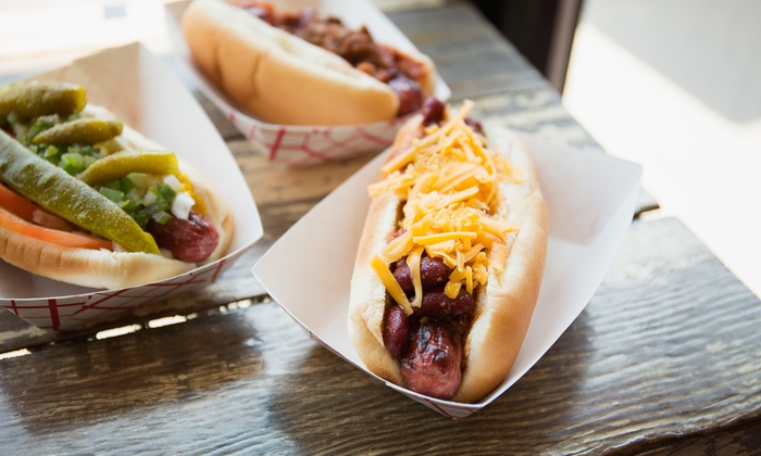Mighty Dogs Cafe and Bistro - Old West Austin: $22 for 4 Groupons, Each Good for 1 Hot Dog & Side Combo for 1 at Mighty Dogs Cafe and Bistro ($34 Value)
