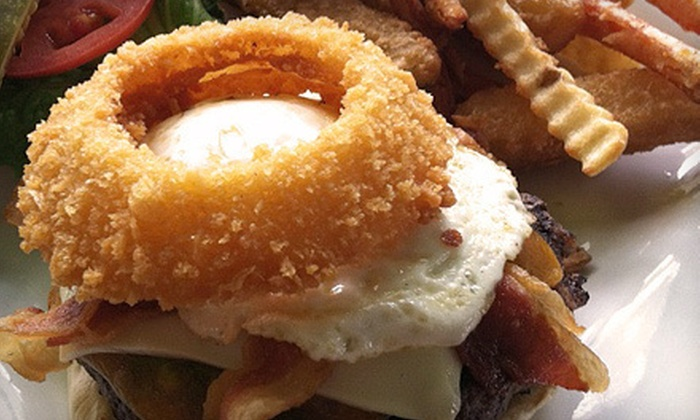 Blue Monkey Bar - Urban Estates: $10 for $20 Worth of Pub Fare and Drinks for Dinner at Blue Monkey Bar