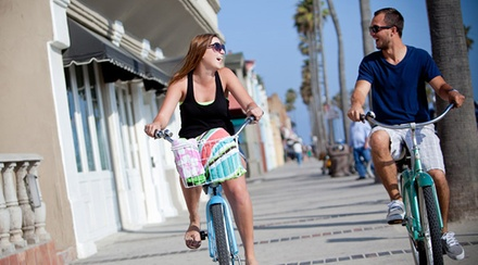 Bike and Surf Rentals from Wheel Fun Rentals (57% Off). Two Options Available.