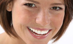 Primadent: Dental Exam with Cleaning, X-rays, and Optional Whitening Treatment at Primadent (Up to 50% Off)