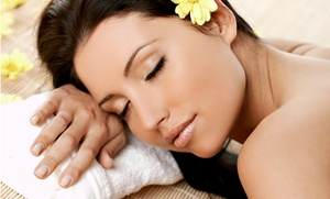 Light Touch Laser Clinic: Choice of 60-Minute Massage, Choice of Facial, or Choice of Both at Light Touch Laser Clinic (Up to 67% Off)