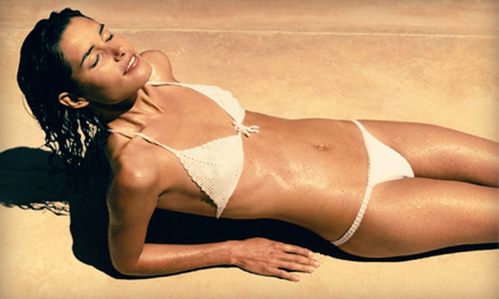 TNT Tanning - Multiple Locations: Three Spray Tans, One Month of Unlimited UV Tanning, or Two Body Wraps at TNT Tanning (Up to 62% Off)
