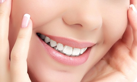 1 o 2 implantes dentales de titanio con corona de metal-porcelana y limpieza bucal desde 449 €