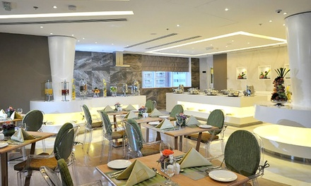 Breakfast, Lunch or Dinner Buffet for Up to Four at Ramada Abu Dhabi (Up to 61% Off)