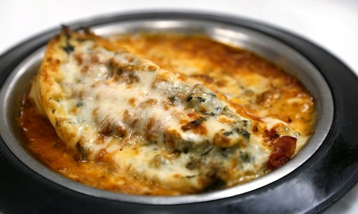 Fletcher's - Panthersville: Wings, Lasagna, Pizza, and Salads at Fletcher's (Up to 50% Off). Two Options Available.