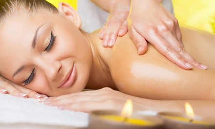 One or Three Groupons, Each Good for a 60-Minute Full-Body Massage at QM Spa (40% Off)