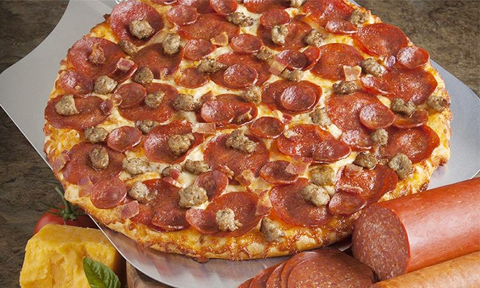 Round Table Pizza - Multiple Locations: One Large 1-Topping Pizza or Two Large Pizzas with Large Salad and Soda at Round Table Pizza (Up to 50% Off)