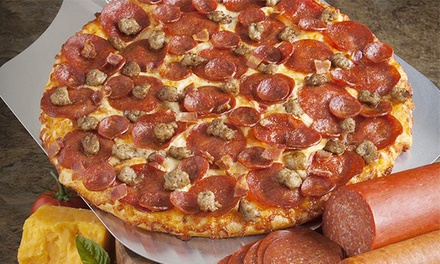 One Large 1-Topping Pizza or Two Large Pizzas with Large Salad and Soda at Round Table Pizza (Up to 50% Off)