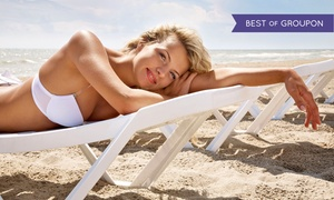 Tan Your Hide: One Month of UV Tanning or Red-Light Treatments, or Two Mystic HD Spray Tans at Tan Your Hide (Up to 76% Off)