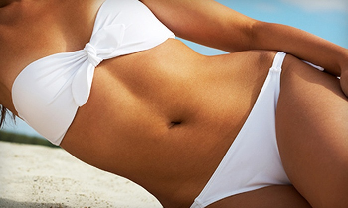 TanQuest Sun Spas - Amherst: One, Three, or Five VersaSpa Spray Tans or Five UV Tanning Sessions at TanQuest Sun Spas (Up to 56% Off)