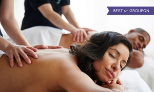 Happy Day Spa: 60-Minute Individual or Couples Massage with Optional Essential Oils at Happy Day Spa (Up to 51% Off)