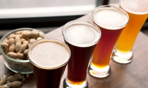 Boulder Dam Brewing: Beer Tasting Flights and Filled 64oz. Growlers for Two or Four at Boulder Dam Brewing (36% Off)