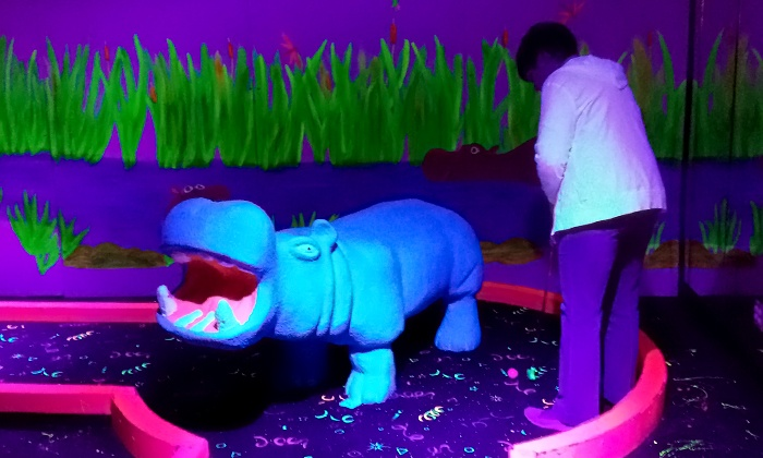 Safari Mini Golf - Safari Mini Golf: 18-Hole Round of Blacklight Mini Golf for Two or Four at Safari Mini Golf (50% Off)