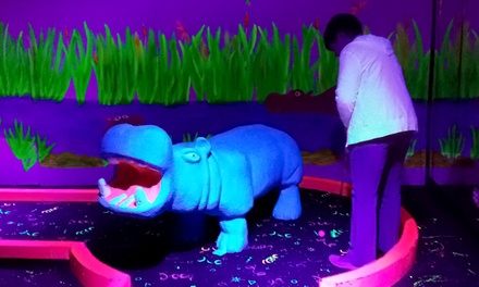 18-Hole Round of Blacklight Mini Golf for Two or Four at Safari Mini Golf (69% Off)