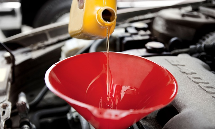 Liner Tire - Brookline: Three or Six Oil Changes and Tire Rotations at Liner Tire (Up to 77% Off)